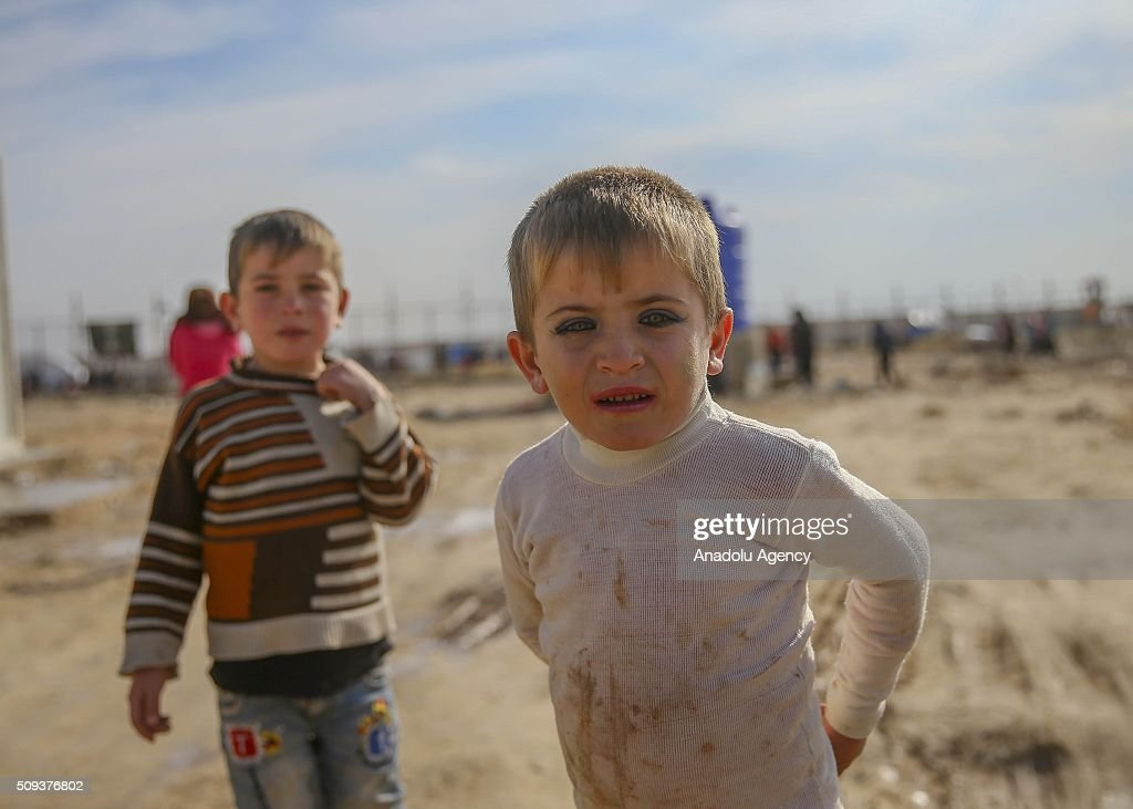Two Syrian kidss who flee the attacks of Syrian and Russian air forces, are seen as they shelter at tents and try to live their lives with humanitarian aid send by Turkey, UNHCR and other Turkish Humanitarian aid organizations, close to the Bab al-Salameh border crossing on Turkish-Syrian border near Azaz town of Aleppo, Syria on February 10, 2016.