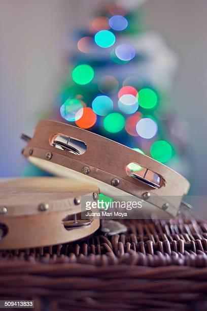 Two tambourines and Christmas lights