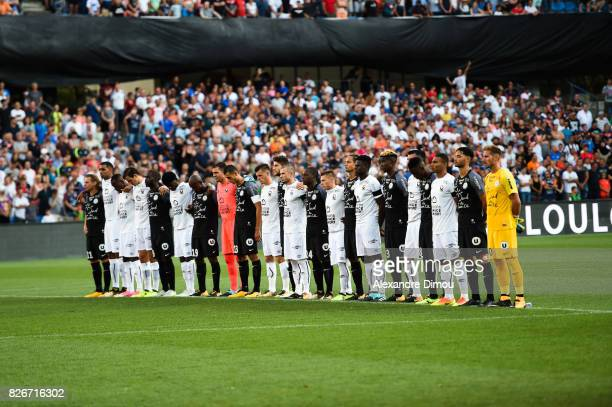 Two teams for minute of silence for tribute to Louis Nicollin during the Ligue 1 match between Montpellier Herault SC and SM Caen at Stade de la...