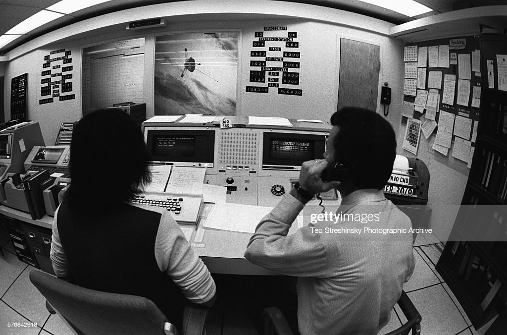Two technicians man the control room for the satellite Pioneer 10 at Moffet Air Force Field in Sunnyvale California | Location Moffet Air Force Field...
