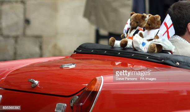 Two teddy bears with St George's flags sit on the back of a MG car taking part in a parade of modern and Classic MG cars in the quadrangle of Windsor...