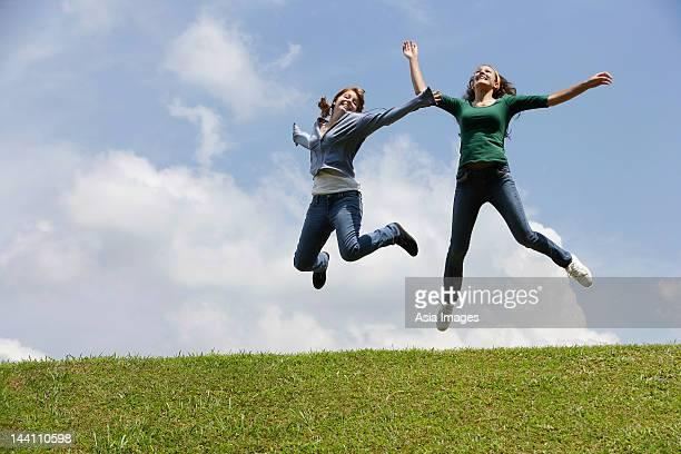 Two teen girls jumping