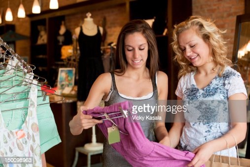 Two Teen Girls Shopping For Clothes At Boutique Stock Photo ...