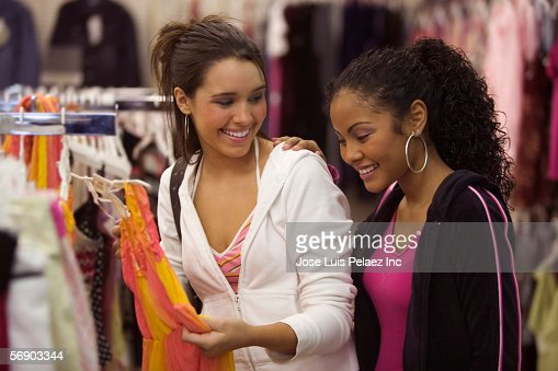 Two Teen Girls Shopping For Clothes Stock Photo | Getty Images