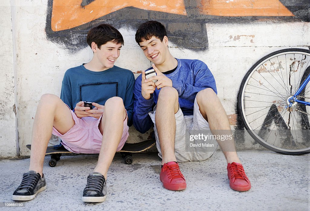 Two teenage boys hanging out together : Stock Photo