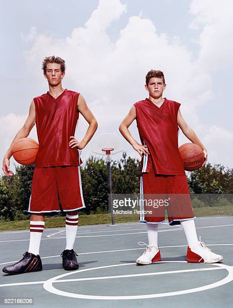 Two Teenage Boys Holding Basketballs