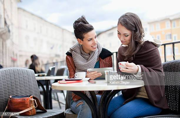 two teenage girls at a café