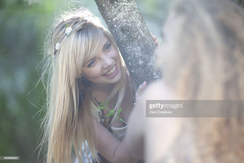 two teenage girls exploring woodland stock photo getty images