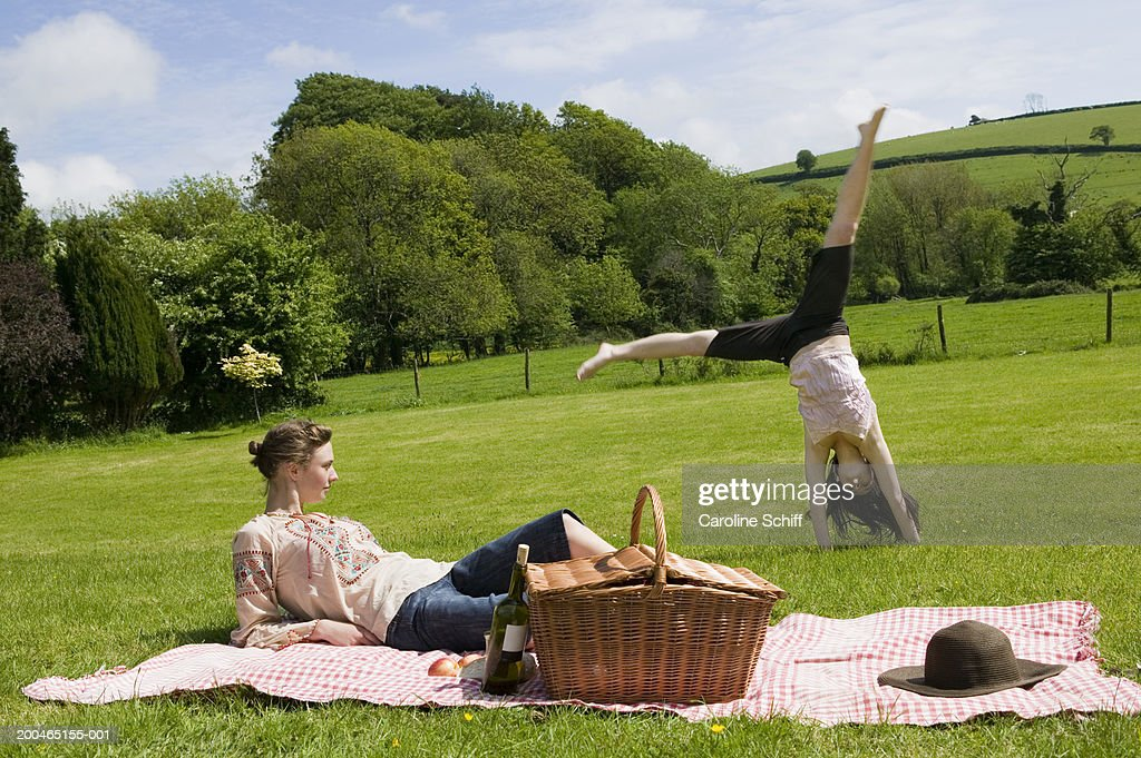 Best friends - two attractive young girls are having a picnic ...