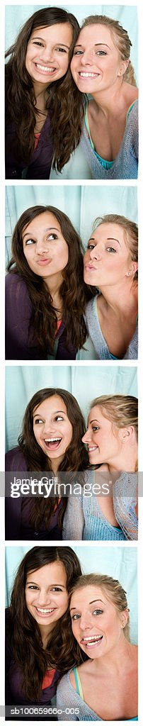 Two teenage girls (14-17) in photo booth : Stock Photo