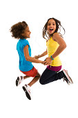 Two young girls jumping