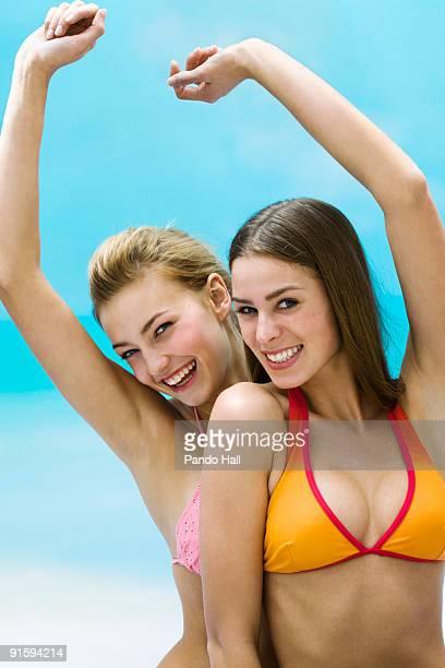 Two Teenage girls laughing, arms raised