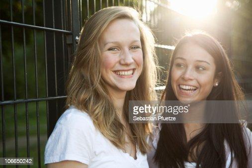 Two teenage girls laughing : Stock Photo