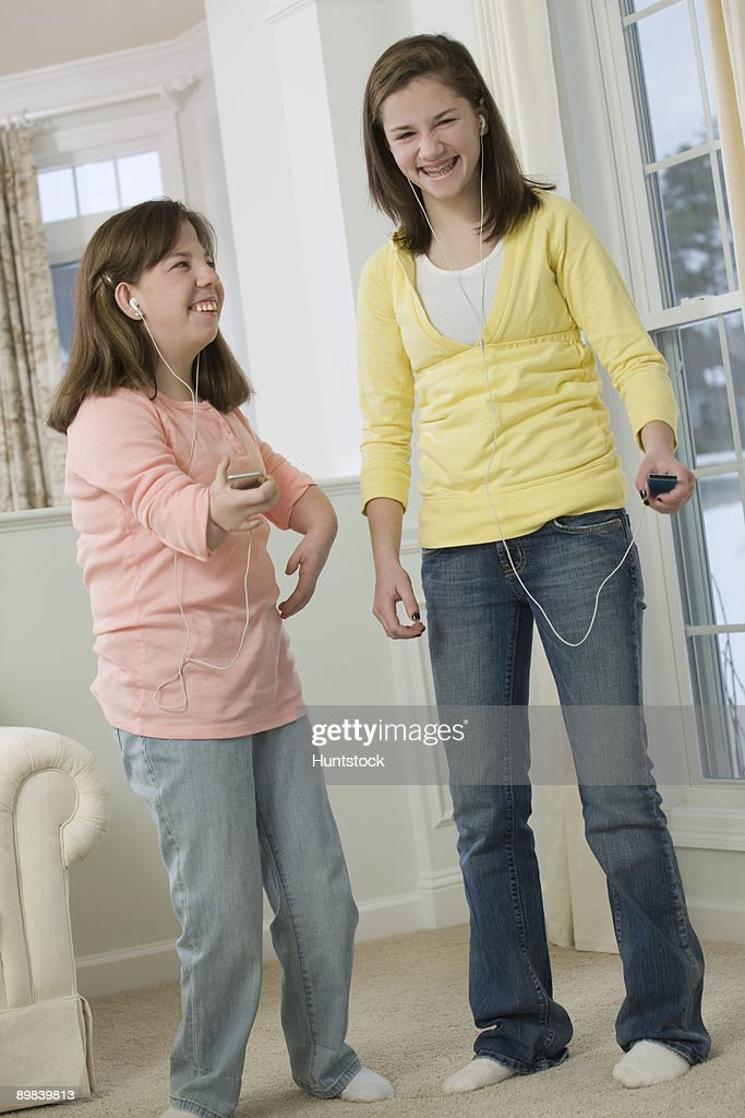 Two teenage girls listening to MP3 players : Photo