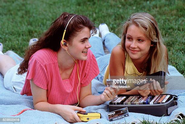 Two teenage girls listening to tapes