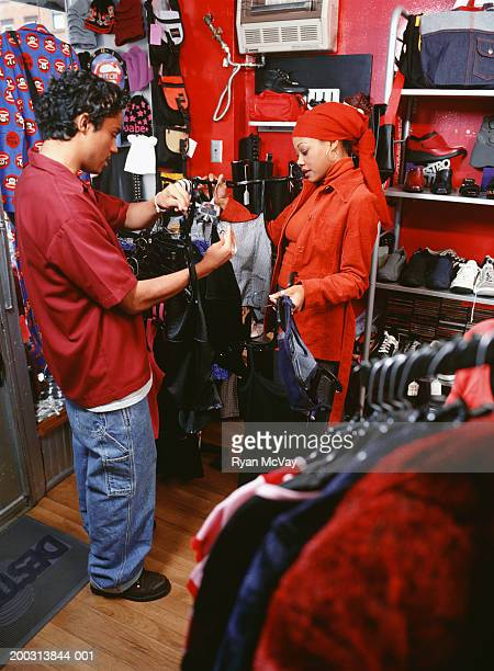 Two teenagers (16-17) choosing clothes in shop