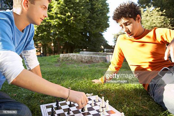 Two teenagers playing chess.