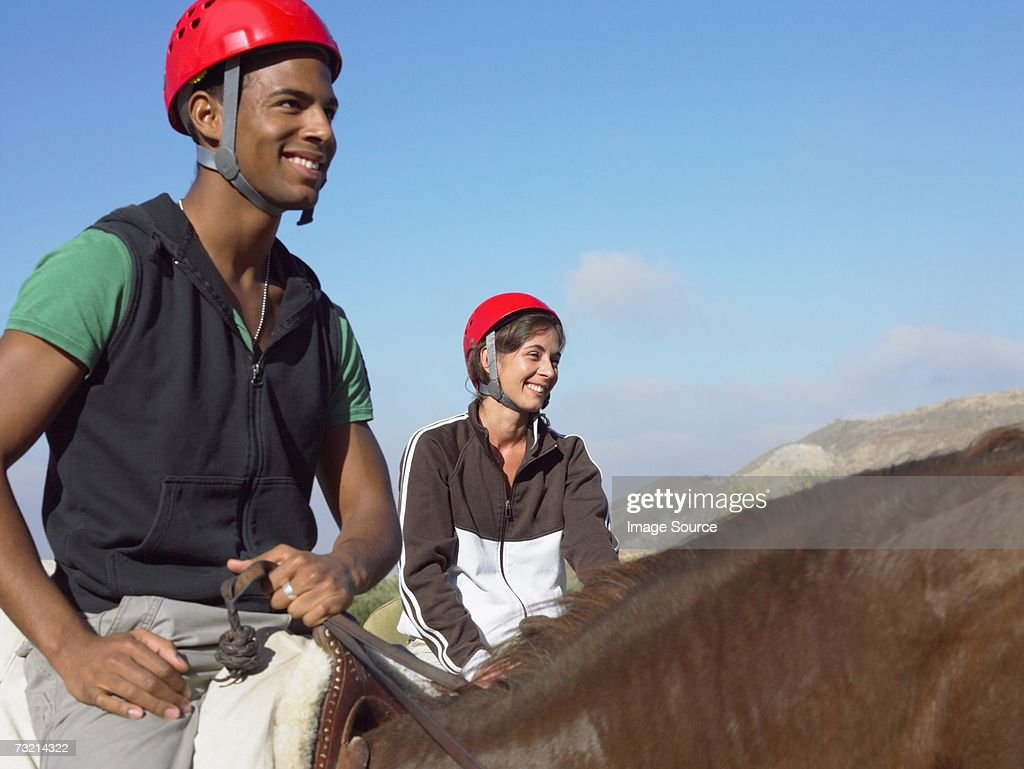 Two teenagers riding horses