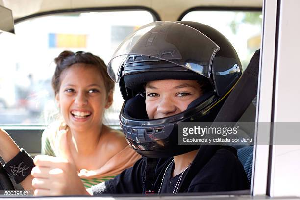 Two teens playing driving a car