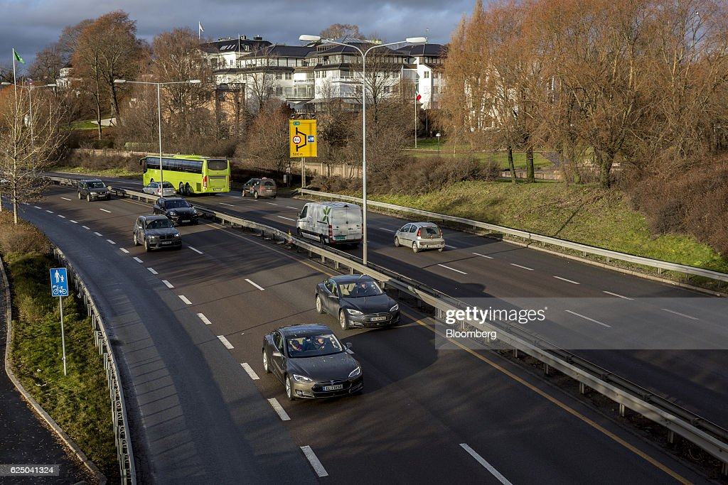 Two Tesla Motors Inc. Model S electric vehicles (EV) travel on the E18 road in Oslo, Norway, on Monday, Nov. 21, 2016. The International Energy Agency forecasts that global gasoline consumption has all but peaked as more efficient cars and the advent of electric vehicles from new players such as Tesla Motors Inc. halt demand growth in the next 25 years. Photographer: Fredrik Bjerknes/Bloomberg via Getty Images