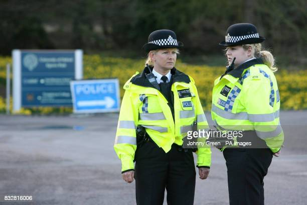 Two Thames Valley Police officers stand outside the entrance to Templeton College in Kennington Oxfordshire after two incendiary devices were found...