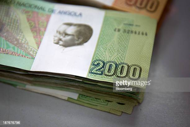 Two thousand denomination kwanza currency banknotes in an office in Luanda Angola on Friday Nov 8 2013 Angola the largest crude oil producer in...