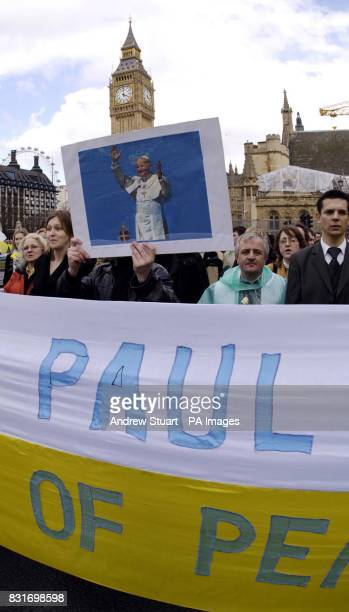 Two thousand Polish catholics make a pilgrimage of peace past the Houses of Parliament in London Sunday April 2 2006 Catholics in the UK and Ireland...