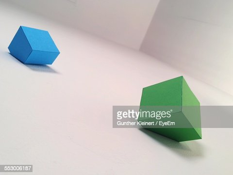 Two Three Dimensional Shapes On White Background