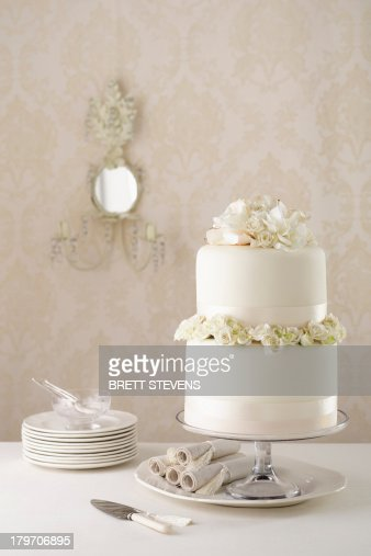 Two tier wedding cake with knife and plates