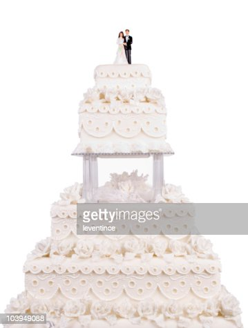Two tier wedding cake with plastic couple on top