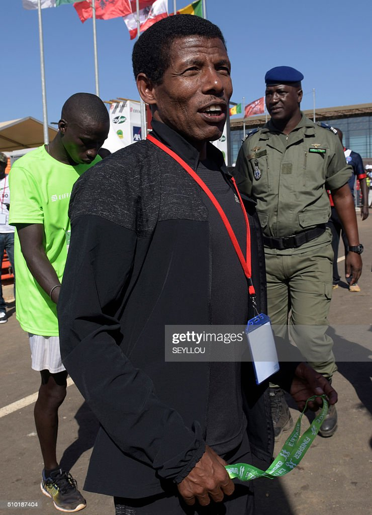 Two time Olympic gold winner and four time gold winner in the World Championships, retired Ethiopian long-distance track and road running athlete Haile Gebrselassie, is seen at the finish line of the first ever Dakar International Marathon, in Dakar on February 14, 2016. The competition organised by the BTP Eiffage society started on February 13 in front of International Conference Center Abou Diouf (Cicad) on the outskirts of Dakar with different runs of 10 km culminariong with a marathon on February 14. The BTP Eiffage society hosted the event to celebrates its 90 years of presence in Senegal. / AFP / SEYLLOU