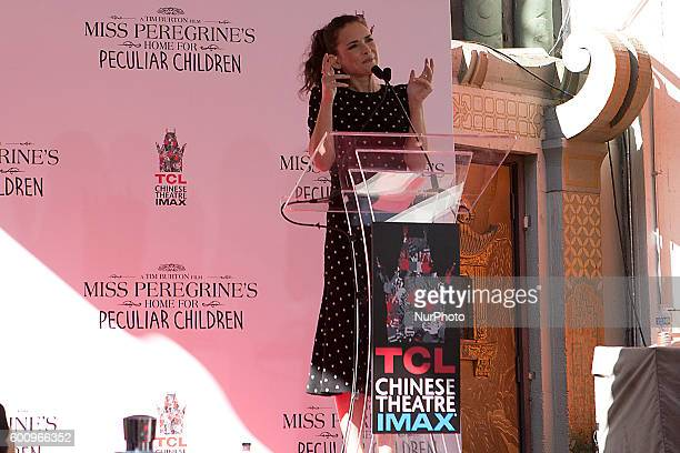 Two time Oscar nominee actress Winona Ryder introducing film director writer and producer Tim Burton during his hand and foot print ceremony this...