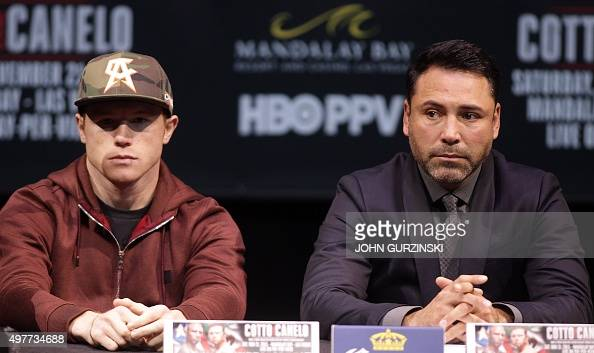Two time world champion Saul 'Canelo' Alvarez Guadalajara Mexico and promoter Oscar De La Hoya listen to former WBC Middleweight World Champion...