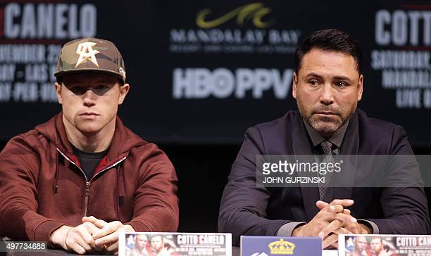 Two time world champion Saul 'Canelo' Alvarez Guadalajara Mexico and promoter Oscar De La Hoya listen to former WBC Middleweight World Champion...