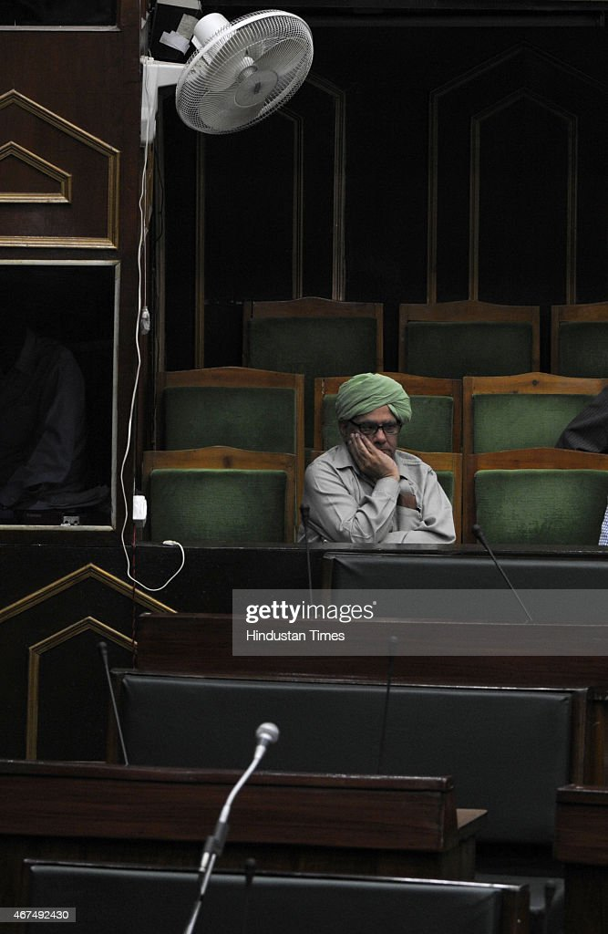 Two times BJP MLA Ashok Khajuria sitting in speakers gallery watching the house proceedings during a Budget session on March 25, 2015 in Jammu, India. Jammu and Kashmir Assembly witnessed ruckus after ruling BJP and PDP members slammed National Conference member Javed Rana for accusing Speaker Kavinder Gupta of being biased and demanded action against him.