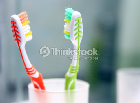 Two toothbrushes in the glass. : Stock Photo
