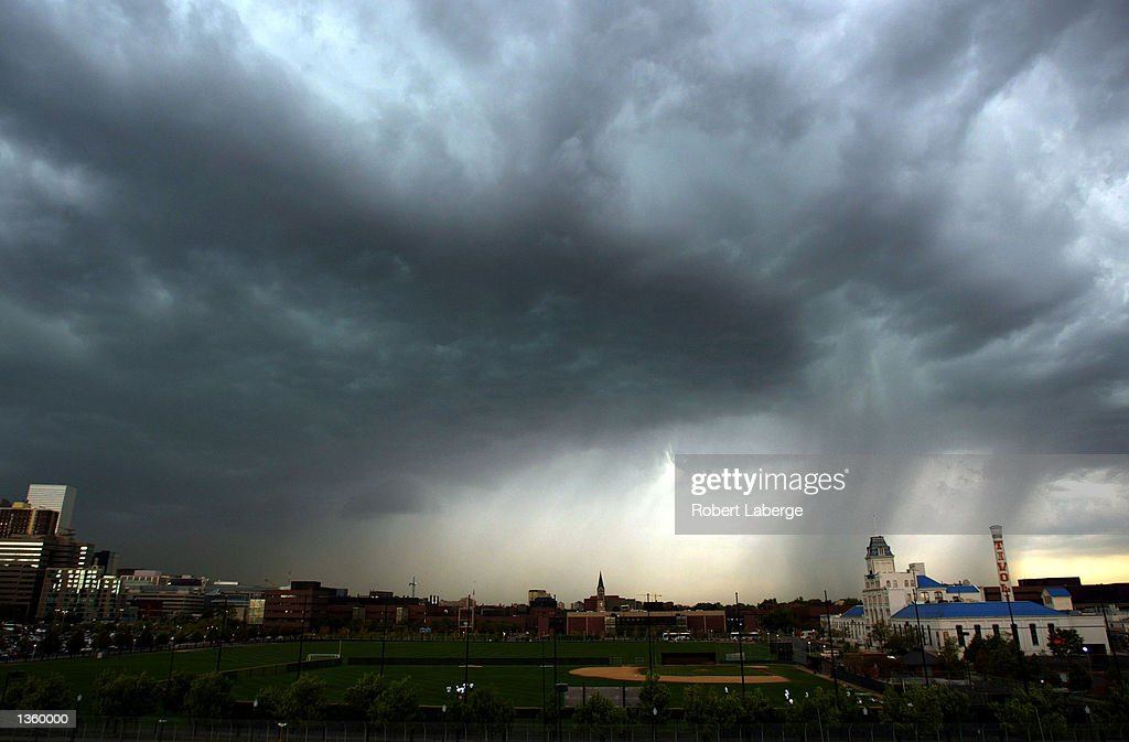 Two tornado funnels touch down close to downtown during a thunderstorm August 29 2002 in Denver Colorado The August 30 forecast for Colorado calls...