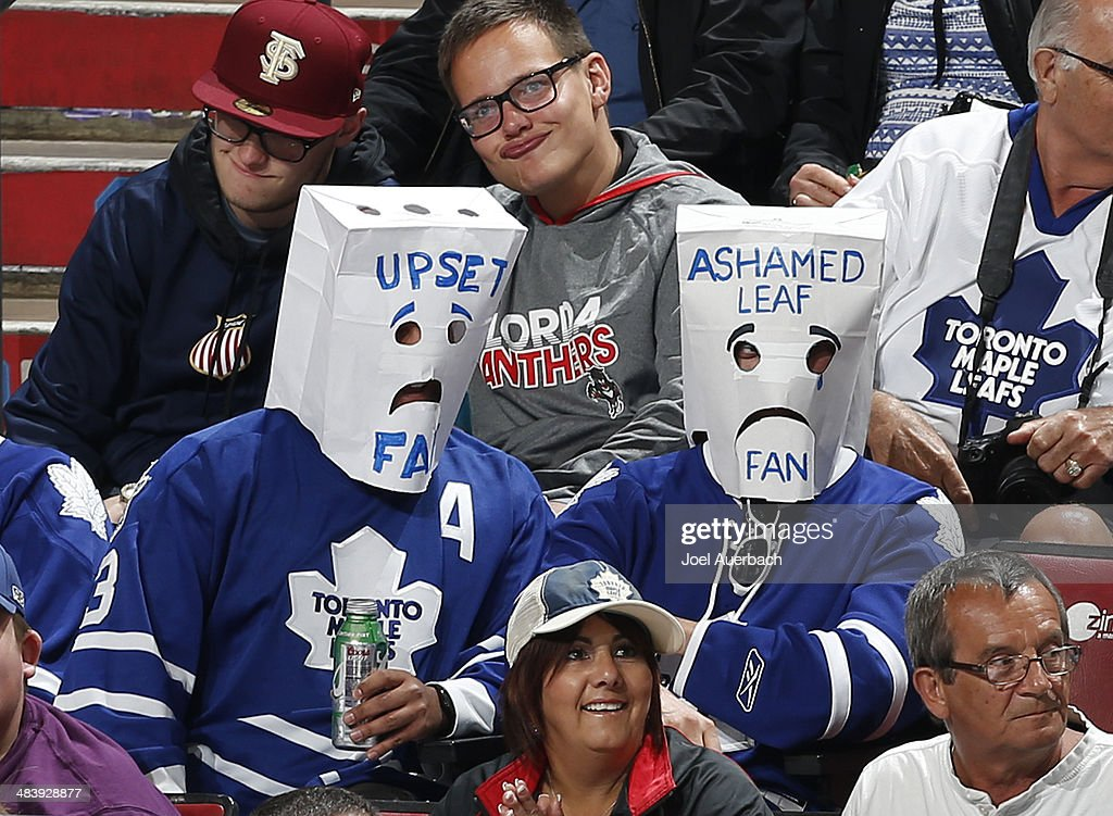 Two Toronto Maple Leafs fans wearing paper bags over their heads watch third period action against the Florida Panthers at the BB&T Center on April 10, 2014 in Sunrise, Florida. The Panthers defeated the Maple Leafs 4-2.