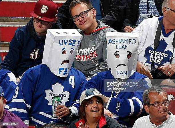 Two Toronto Maple Leafs fans wearing paper bags over their heads watch third period action against the Florida Panthers at the BBT Center on April 10...