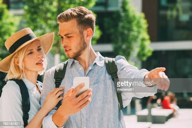 Two tourist orientating with smartphone