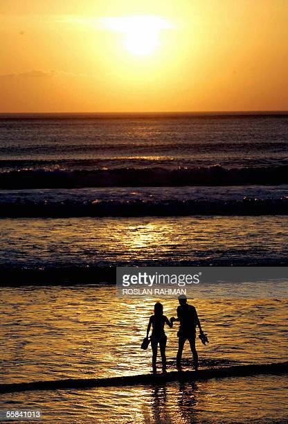 Two tourists walk along Kuta beach during sun set in Bali 03 October 2005 A series of bomb attacks hit the Indonesian resort island of Bali 01...