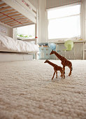 two toy giraffes on childrens bedroom floor
