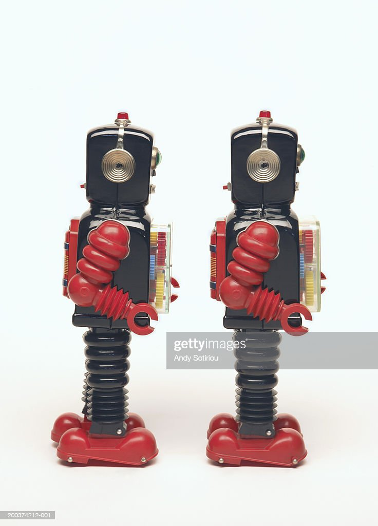 Two toy robots side by side, side view : Stock Photo