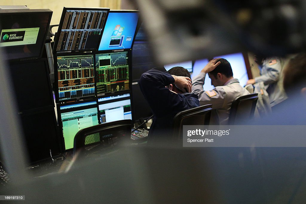 Two traders work on the floor of the New York Stock Exchange on May 21, 2013 in New York City. Following comments from a Federal Reserve official indicating that the central bank will continue to flow money into the financial system, stocks rose Tuesday with the Dow Jones industrial average closing up 52.20.