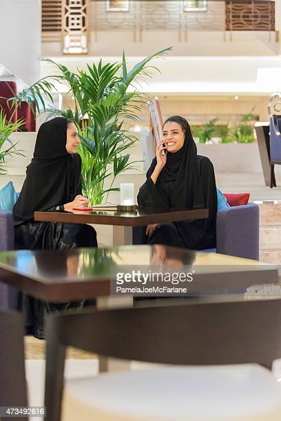 Two Traditionally Dressed Middle Eastern Women in Hotel Lounge Café