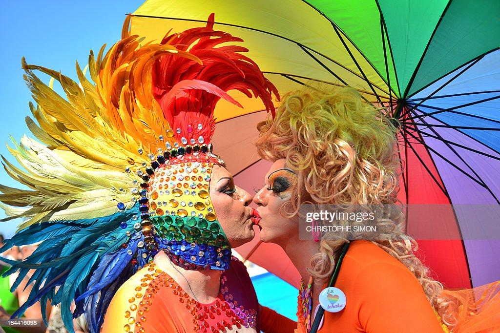 Two transvestites kiss during the gay pride parade at Copacabana beach in Rio de Janeiro, Brazil on October 13, 2013.
