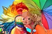 Two transvestites kiss during the gay pride parade at Copacabana beach in Rio de Janeiro Brazil on October 13 2013 AFP PHOTO / CHRISTOPHE SIMON