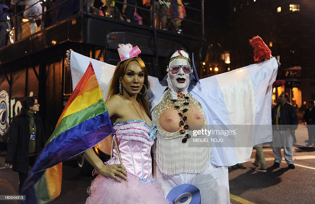Two transvestites pose for a picture before the start of the March for Diversity, on September 27, 2013 in Montevideo. AFP PHOTO/ Miguel ROJO