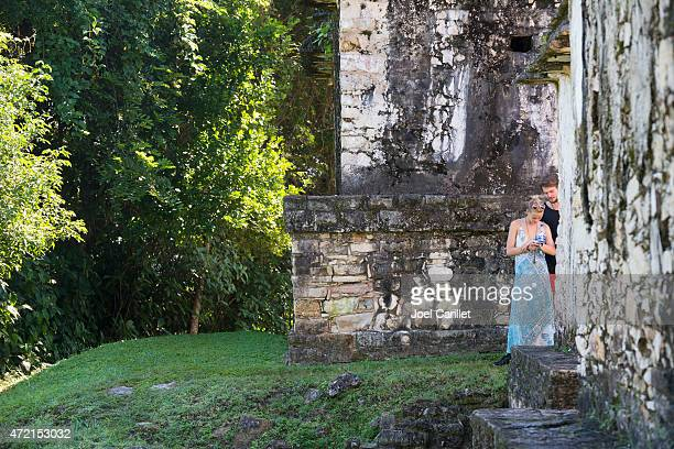 Two travelers in ruins of Palenque, Mexico