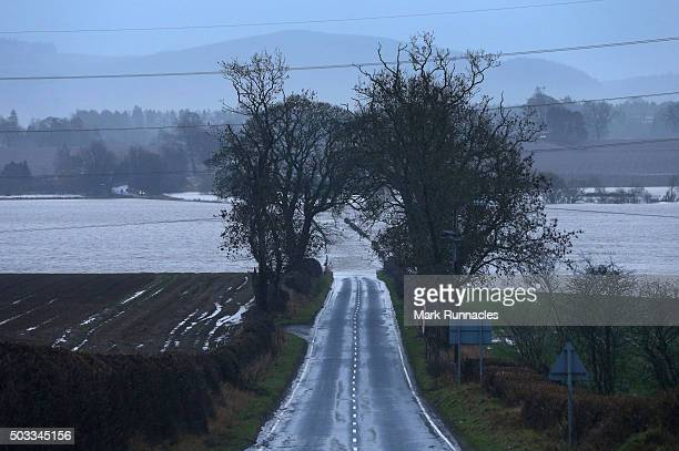 Two trees separate a road as the rain falls flooding the B945 in Perthshire on January 4 2016 near Blairgowrie United Kingdom Stormy weather...